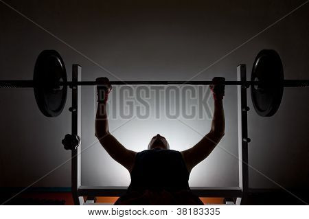 Man Weightlifter At The Gym