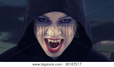 Angry Woman Vampire Against The Dark Sky