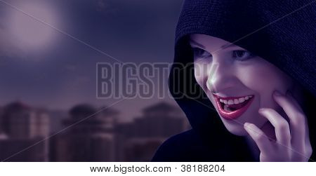 Beautiful Witch In A Black Hood On The Day Of Halloween