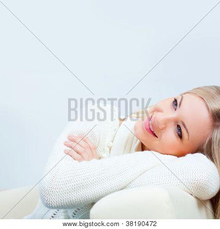 happy woman wearing  white sweater