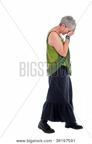 Sad Older Woman Stands In Loose Flowing Long Dress
