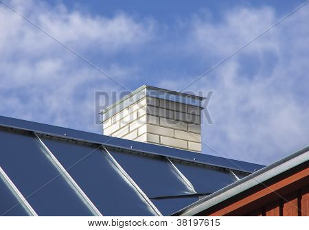 New Metal Roof With White Chimney