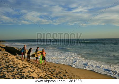 Young Surfers Checking Out The Wave Situation