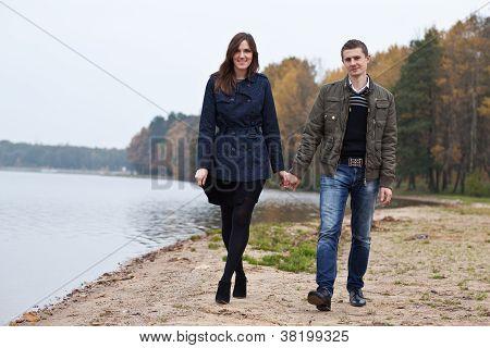 Young Couple Walking On Lake