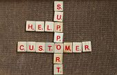 picture of scrabble  - costumer service arrange in scrabble with wood backround - JPG