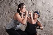 pic of boot camp  - Caucasian athlete sweating with trainer in boot camp training workout - JPG