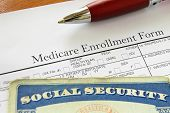 stock photo of social-security  - Social Security card and Medicare enrollment form - JPG