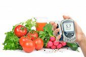 stock photo of diabetes  - Diabetes concept glucose meter in hand and healthy organic food - JPG