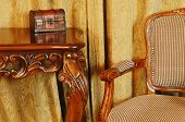 stock photo of no clothes  - Fragment Of The Interior With Antique Furniture And Coffret On The Table - JPG