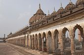 stock photo of imambara  - Classical islamic architecture on the roof of the 18th Century Bara Imambara in Lucknow Uttar Pradesh India