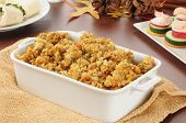 stock photo of canapes  - A casserole dish of turkey stuffing with canapes and pinwheel sandwiches - JPG