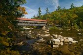 image of covered bridge  - Albany Bridge in New Hampshire on a beautiful October autumn day. Originally built in 1858.