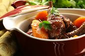 Traditional French cuisine - chicken in wine, coq au vin