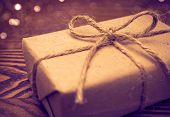 foto of gift wrapped  - Gift wrapped in paper in the wooden backgroud - JPG