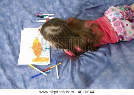 Little Cute Smiling Girl Seven Years Old With Drawing Picture
