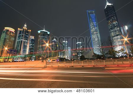 Modern Office Building Background Of Car Night With Light Trails