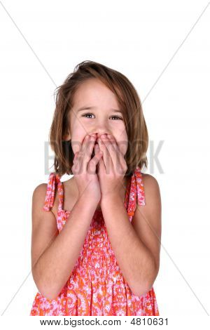 Cute Girl In Bright Dress With Hands Over Mouth