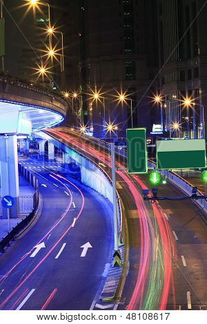 Megacity Highway At Night With Light Trails In Shanghai