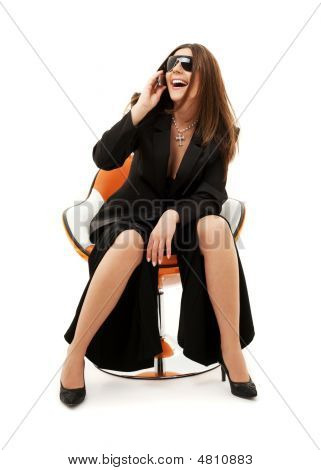 Businesswoman With Phone In Orange Chair