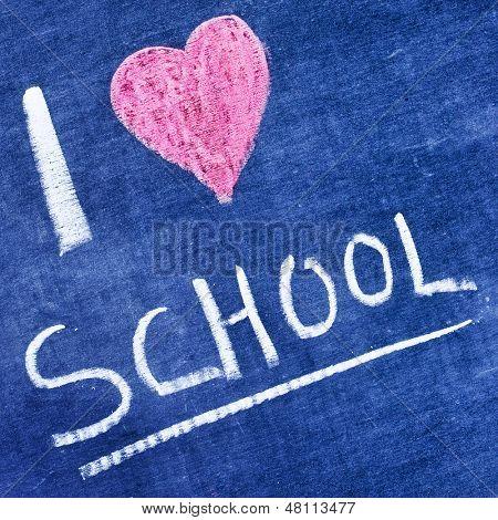 sentence I love school written with chalk in a blackboard