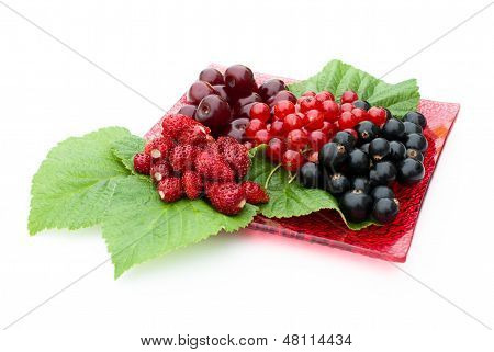 Different Berries Lying On A Red Plate