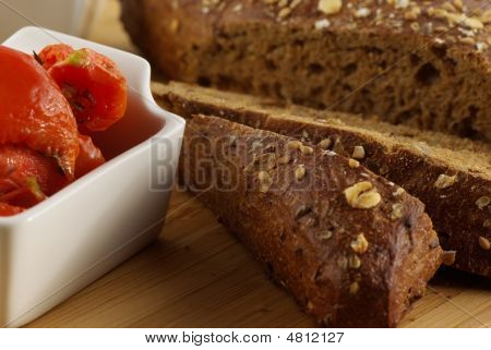 Plate Of Sliced Bread And A Bowl With Tomatoes Isolated On White