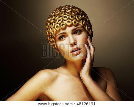 Creativity. Surreal Portrait Of Stylized Woman With Golden Headwear As A Helmet