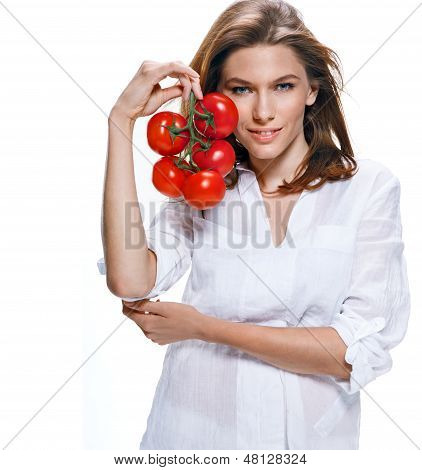 Young beautiful woman with bunch of tomatoes in hand isolated on white background