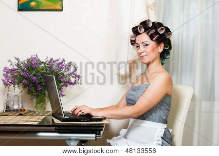 beautiful woman in the kitchen with notebook