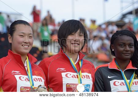DONETSK, UKRAINE - JULY 11: Medalists in Discus Throw on World Youth Championships in Donetsk, Ukraine on July 11, 2013. Left to right: Xinyun Liang, Yuchen Xie, both - China, Claudine Vita, Germany