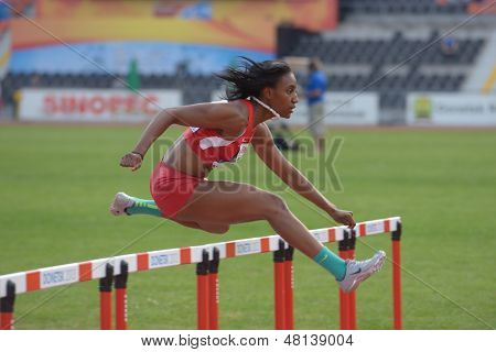 DONETSK, UKRAINE - JULY 11: Dior Hall of USA competes in semi-final of 100 m hurdles during 8th IAAF World Youth Championships in Donetsk, Ukraine on July 11, 2013