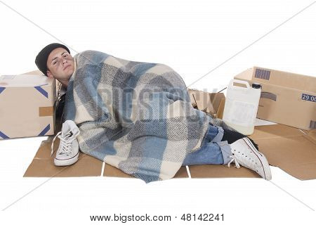 Homeless Lying On Cardboard