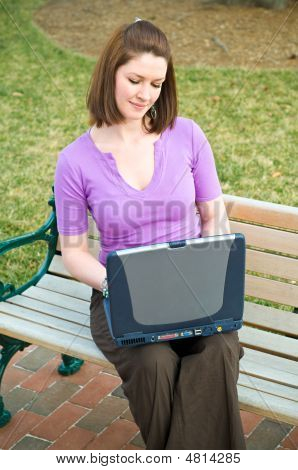 Pretty Young Student Girl Using Internet Laptop Technology