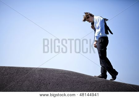 Businessman climbing a hill