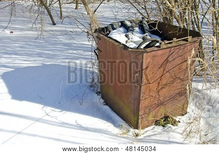 Old Rusty Rubbish Container On Snow