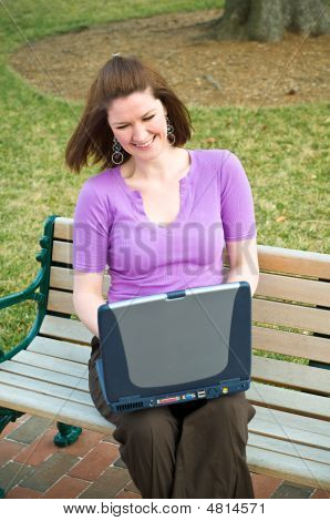 Laughing Young Student Girl Using Internet Laptop Technology