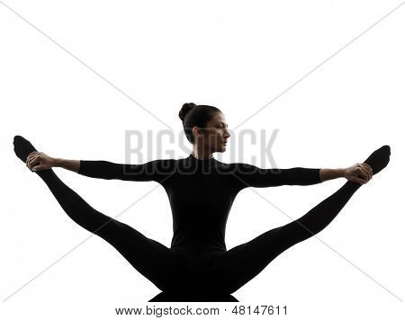 one caucasian woman practicing gymnastic yoga stretching split  in silhouette   on white background