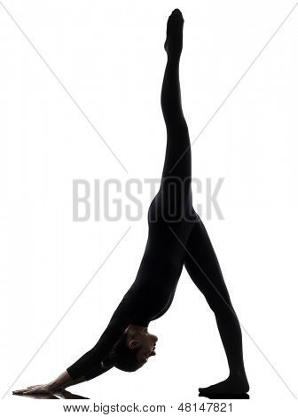 one caucasian woman practicing gymnastic yoga  Adho Mukha Svanasana in silhouette   on white background