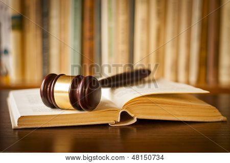 Open Law Book With A Judges Gavel