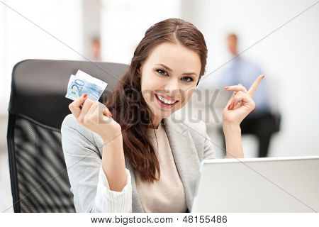 business, money and internet - pensive businesswoman with cash money in office