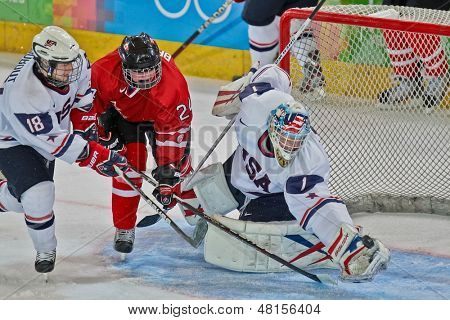 INNSBRUCK, AUSTRIA - JANUARY 15 Edwin Minney (USA) catches the puck a Canada beats the USA 5:1 in the men's ice hockey tournament on January 15, 2012 in Innsbruck, Austria.