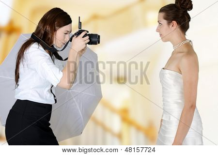 Woman in a wedding dress getting picture taken