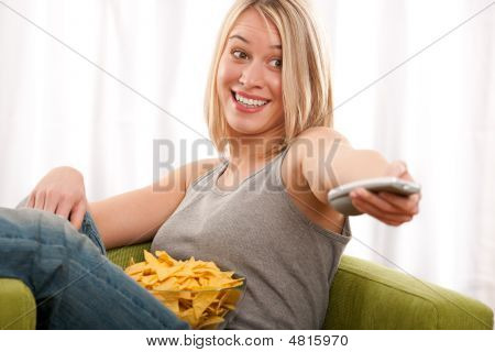 Student Series - Young Blond Woman Watching Tv