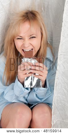Beauty Woman In Man Shirt Is Eating Chocolate