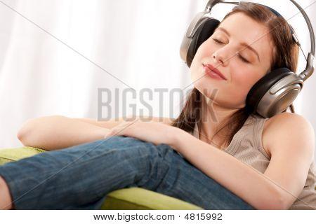 Student Series - Young Brunette Enjoying Music