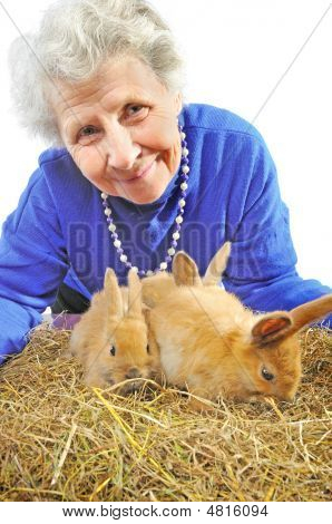 Elderly Happy Woman With Rabbits