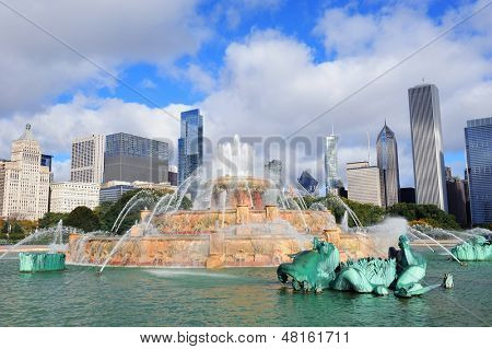 Chicago skyline panorama with skyscrapers and Buckingham fountain in Grant Park in the morning with cloud and blue sky.