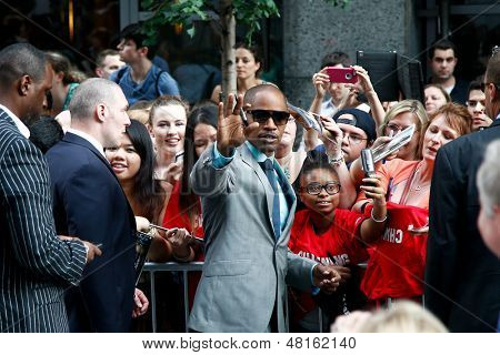 """NEW YORK-JUNE 25: Actor Jamie Foxx signs autographs at  the premiere of """"White House Down"""" at the Ziegfeld Theater on June 25, 2013 in New York City."""