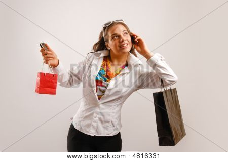 Attractive Beautiful Young Woman Talking At The Phone And Holding