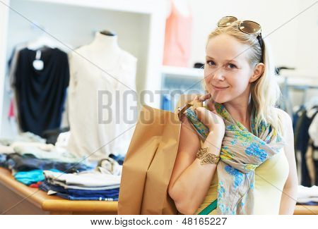 woman buyer with apparel purchase during garments clothing shopping at clothes store